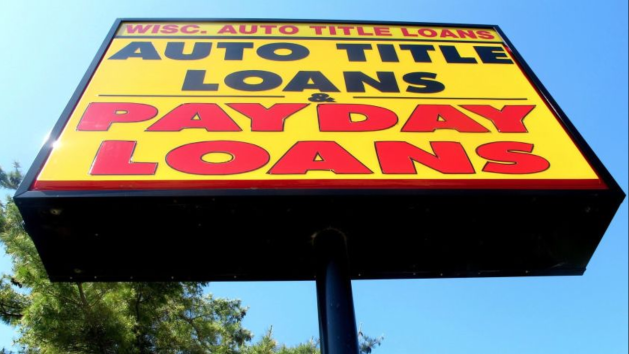 Sign showing title loans and payday loans